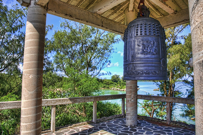 Okinawa World Peace Bell with view to ocean